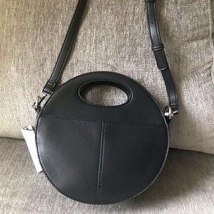 Round cross-body handbag